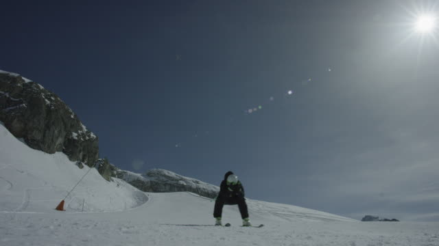 steady shot of skier skiing downhill straight towards the camera. - straight stock videos and b-roll footage