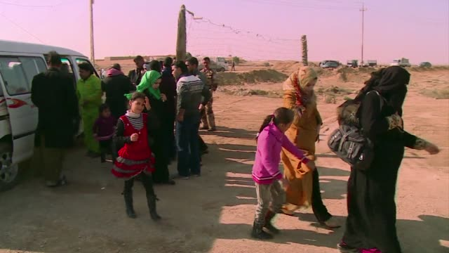 a steady stream of families fleeing fighting in ramadi and fallujah is arriving at a checkpoint in iraq's karbala province seeking shelter from the... - al fallujah stock videos and b-roll footage