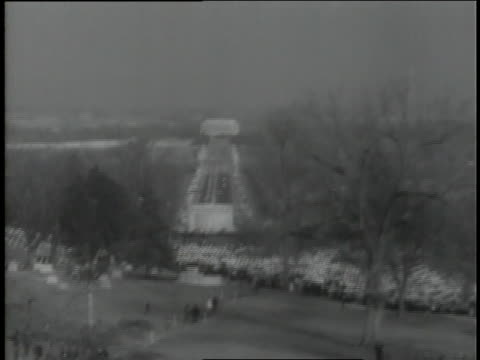 a steady stream of mourners passes by the grave of assassinated u.s. president john f. kennedy at arlington national cemetery. - john f. kennedy us president stock videos and b-roll footage