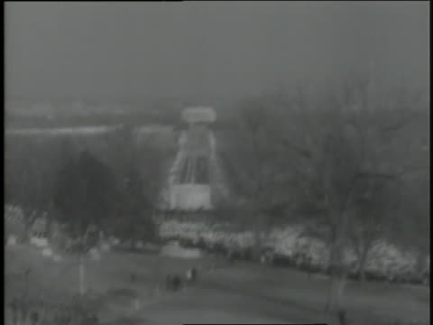 a steady stream of mourners passes by the grave of assassinated u.s. president john f. kennedy at arlington national cemetery. - arlington virginia stock videos & royalty-free footage