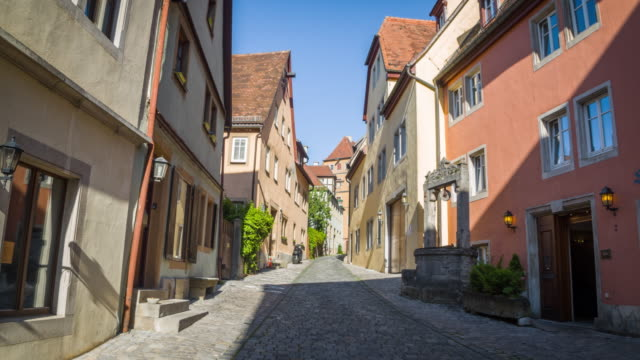 steadycam: medieval street of rothenburg ob der tauber in germany. - european culture stock videos & royalty-free footage