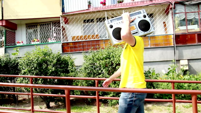 steadycam shot of man walking with boombox