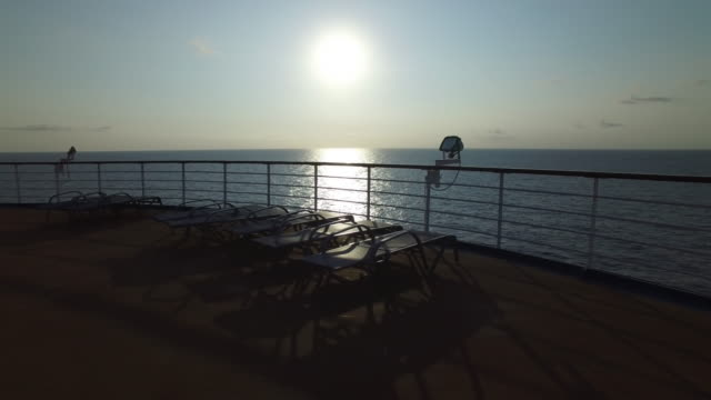 Steadycam Shot of Ocean Sunrise and Cruise Ship Chairs