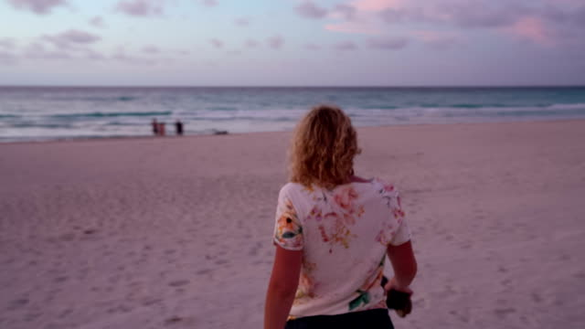 steadycam shot of young woman walking on the beach - varadero stock videos and b-roll footage