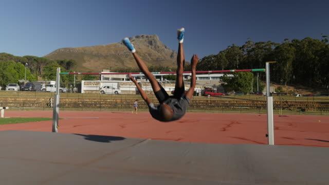 WS STEADYCAM_Male athlete doing high jump, at stadium