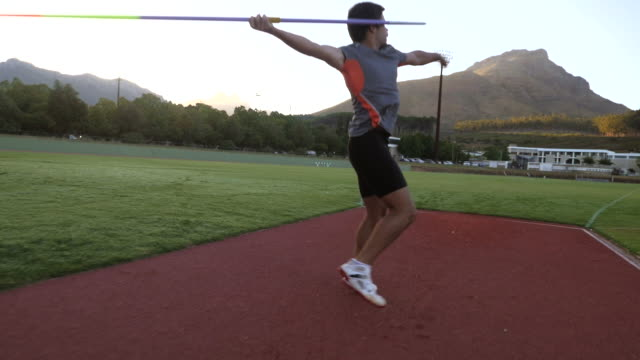 STEADYCAM_Male track athlete throwing javelin