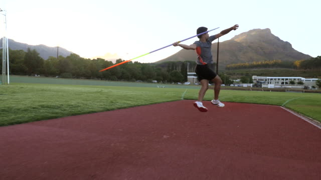 steadycam_male track athlete throwing javelin - javelin stock videos & royalty-free footage