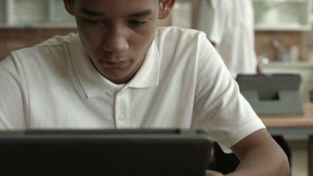 CU STEADYCAM_School student using digital tablet