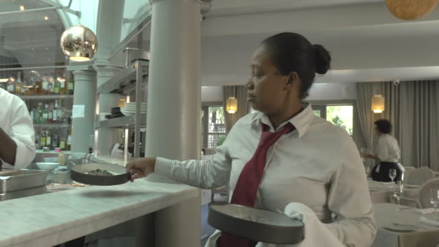 MS STEADYCAM_Waiter picking up dishes and walking threw restaurant, to serve for guests