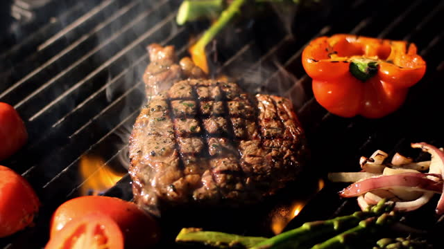 steak and vegetables sizzle on a grill. - steak stock videos & royalty-free footage