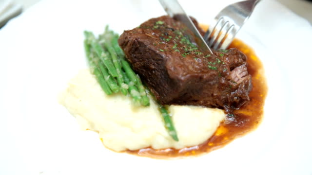 steak at restaurant - gourmet stock videos & royalty-free footage