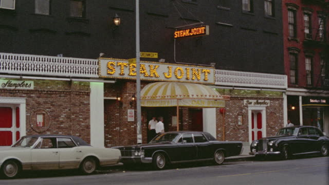 1969 ws zi steak joint restaurant on greenwich avenue with cars parked outside / manhattan, new york - greenwich village stock videos & royalty-free footage