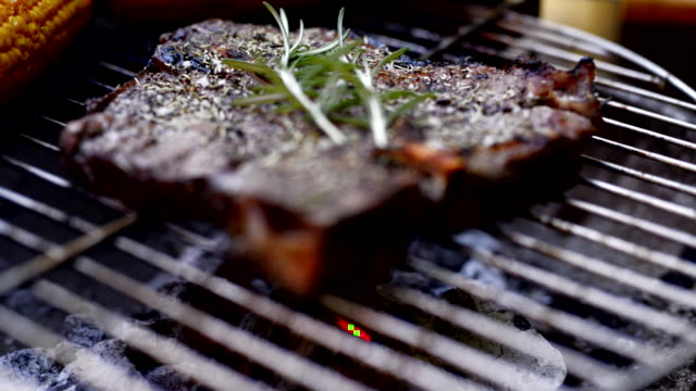 steak on a barbecue grill. - kohle stock-videos und b-roll-filmmaterial