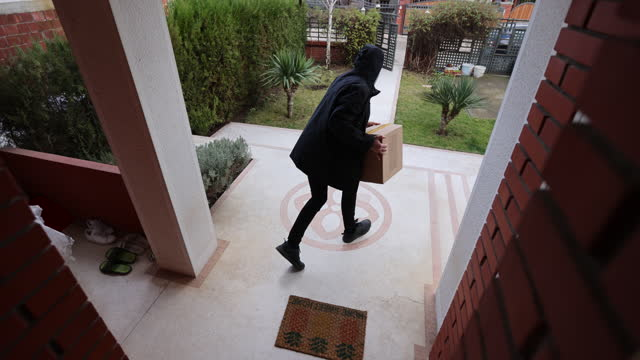 stealing delivery package - moving image stock videos & royalty-free footage