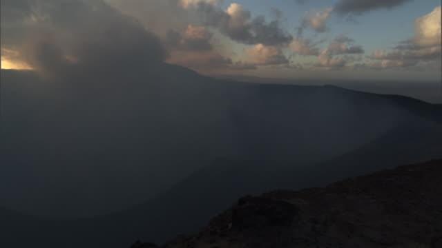 Steam and ash rises from volcano crater, Mount Yasur, Vanuatu