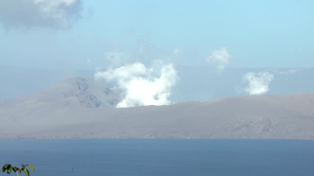 steam and gas rise from crater of taal volcano after the major eruption on 12th january 2020 - taal volcano stock videos & royalty-free footage
