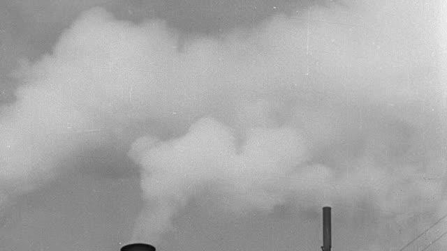 montage steam and smoke billowing out of smokestacks - 1931年点の映像素材/bロール