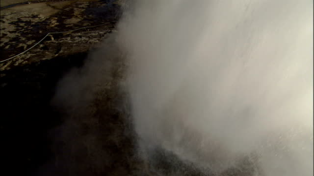 Steam and water erupt from a geyser in Strokkur Iceland. Available in HD.