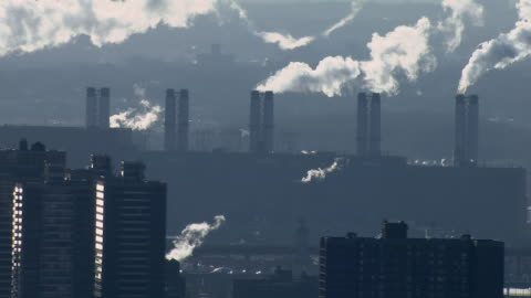 steam billowing from the smokestacks at astoria generating station, a combined cycle power plant on the east river in queens, new york city. - fumes stock videos & royalty-free footage