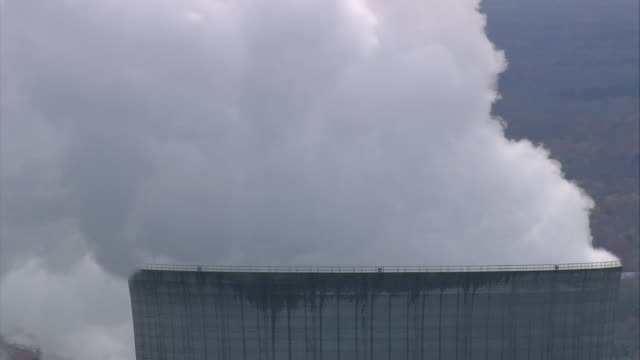 aerial steam billowing from top of cooling tower at nine mile point nuclear station / new york, united states - electrical component stock videos & royalty-free footage