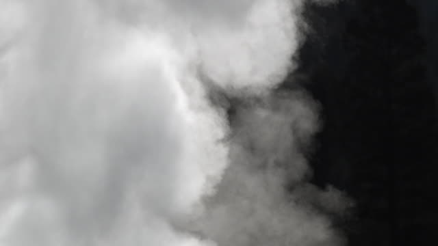 steam billows as water sprays from erupting geyser. - steam stock videos & royalty-free footage