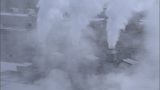 steam billows from a paper mill. - paper mill stock videos & royalty-free footage