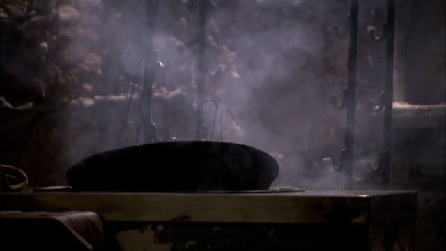 steam billows from a tandoor oven. - oven stock videos and b-roll footage