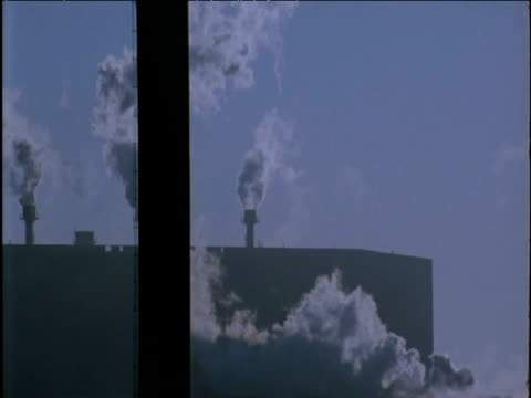 Steam billows from chimneys Katowice Steel Works Poland
