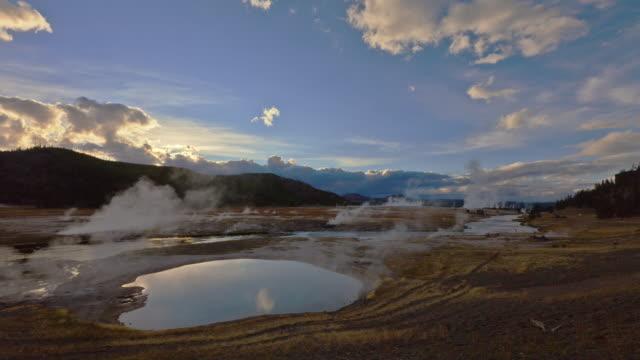 steam billows from geyser basins in yellowstone national park. - geysir stock-videos und b-roll-filmmaterial