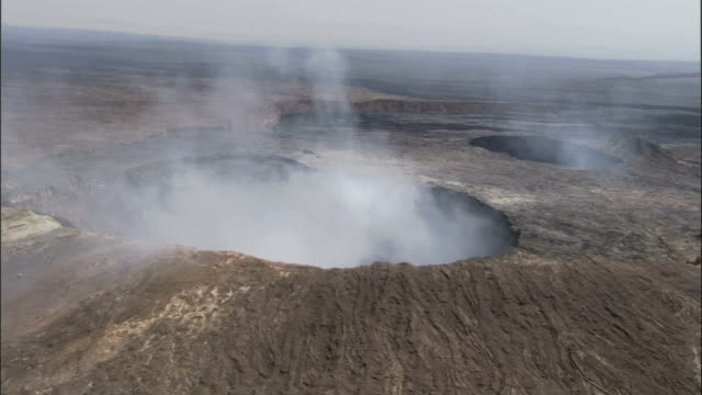 steam billows out of the crater of the erte ale volcano in ethiopia. available in hd. - ale stock videos & royalty-free footage