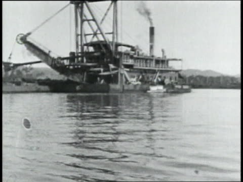 montage steam boat carrying crane that is excavating in water for panama canal / republic of panama - anno 1906 video stock e b–roll