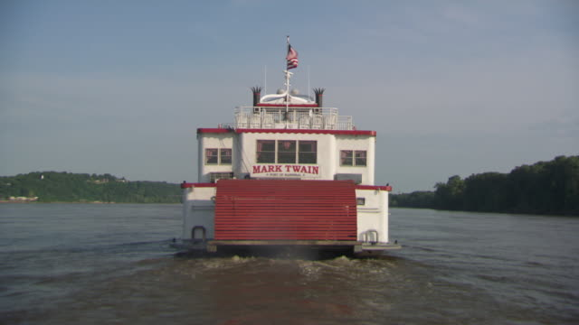 ws pov steam boat moving in hannibal mississippi river / hannibal, missouri, united states - mark twain stock videos & royalty-free footage