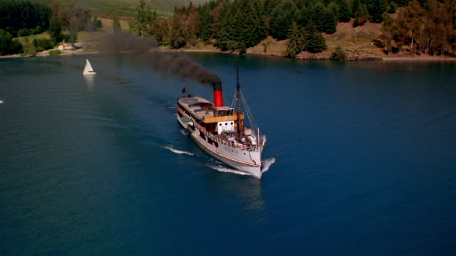 low aerial, steam boat on lake, south island, new zealand - steam liner stock videos & royalty-free footage