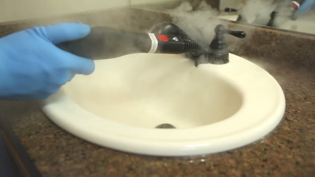 Steam Cleaning Bathroom Sink and Faucet