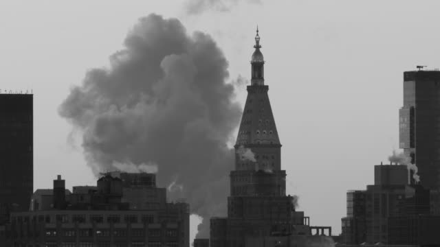 Steam clouds rise around the Met Life Building in Manhattan.