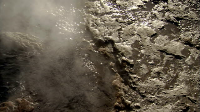 Steam drifts above a geyser in Strokkur Iceland. Available in HD.