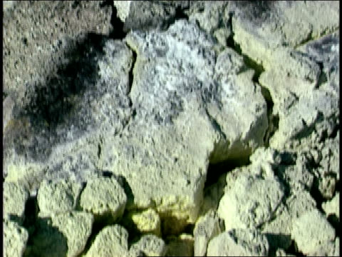 vídeos de stock e filmes b-roll de steam drifts above sulfur deposits. - forma de água