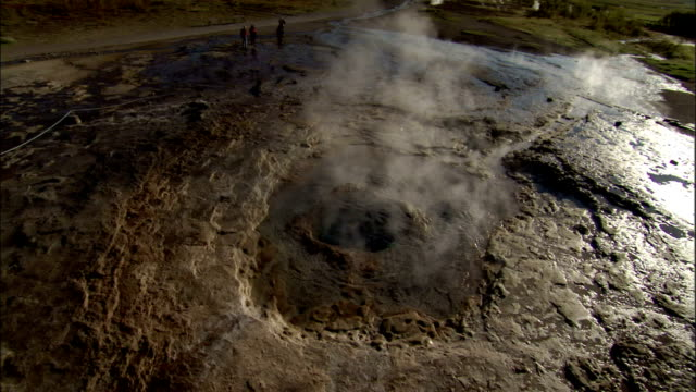 Steam drifts from a geyser at Strokkur Iceland. Available in HD.