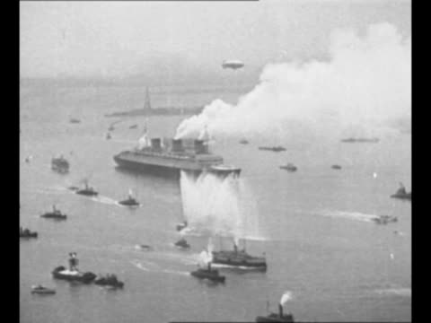 cu steam emanates from ss normandie / pov from aboard ship of new york city skyline in background ship equipment stands in foreground / 1935... - normandy stock videos & royalty-free footage