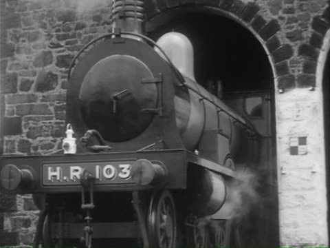 ms ts cu steam engine at sheds, details of train, driver connecting engine to cart / united kingdom - lokomotive stock-videos und b-roll-filmmaterial