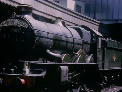 ms steam engine in motion and man boarding wooden carriages in train / hertfordshire, england - locomotive stock videos & royalty-free footage