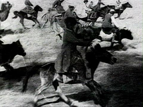 steam engine men on horseback chasing train riding mules audio/ russia - anno 1928 video stock e b–roll