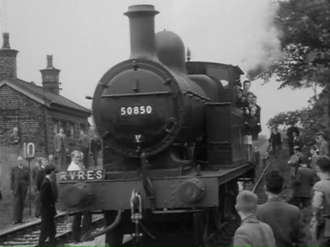 ms cu steam engine moves slowly into station watering engine boarding in motion / manchester, lancashire, england - lancashire stock videos & royalty-free footage