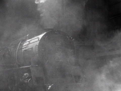 a steam engine pulls out of the newtonlewillows foundry in lancashire 1953 - lancashire stock videos and b-roll footage