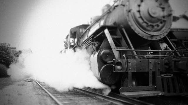 stockvideo's en b-roll-footage met steam engine train leaves station - bw - locomotief