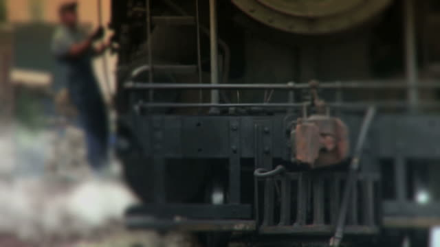 stockvideo's en b-roll-footage met steam engine train passes by - color - locomotief