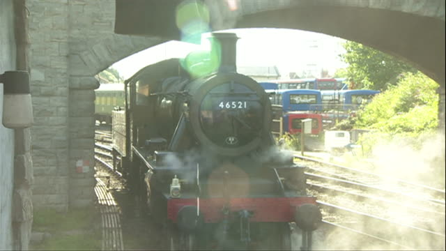 steam engine train pulling out of station on swanage heritage steam railway - steam stock videos & royalty-free footage