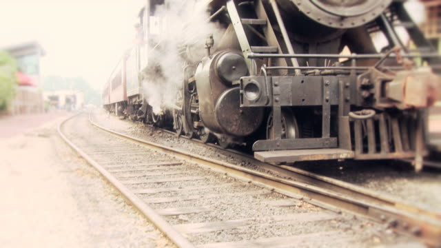 steam engine train waits at station - locomotive stock videos and b-roll footage