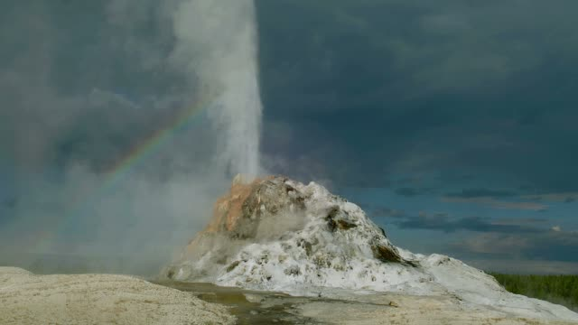 steam erupts out of a geyser in yellowstone park. - geyser stock videos and b-roll footage