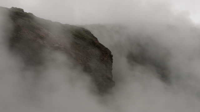 steam flows from a geothermal pool of water.  - dampf stock-videos und b-roll-filmmaterial